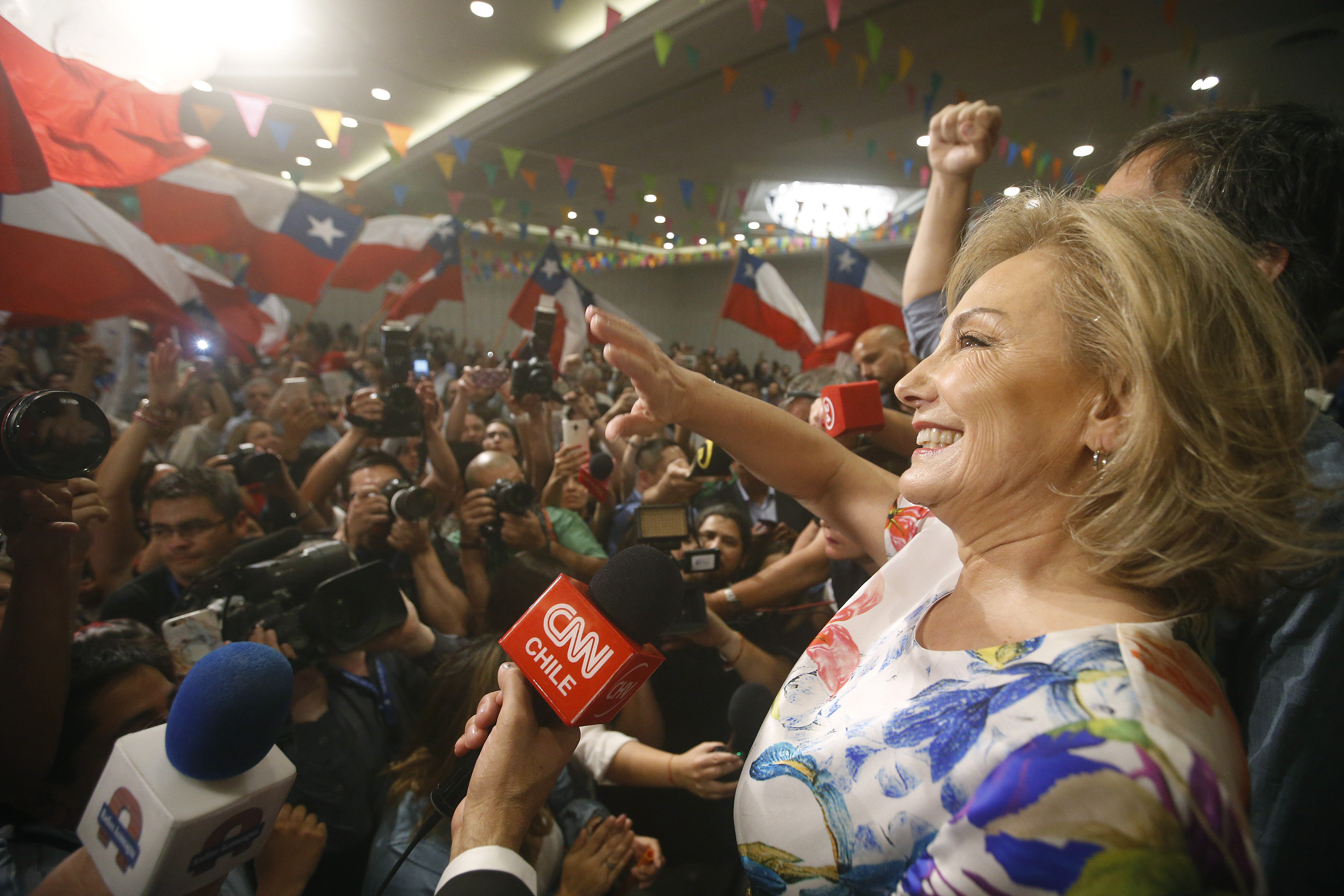 Cecilia Morel, the wife of conservative presidential candidate Sebastian Piñera, greets supporters awaiting preliminary results of the Dec. 17, 2017,