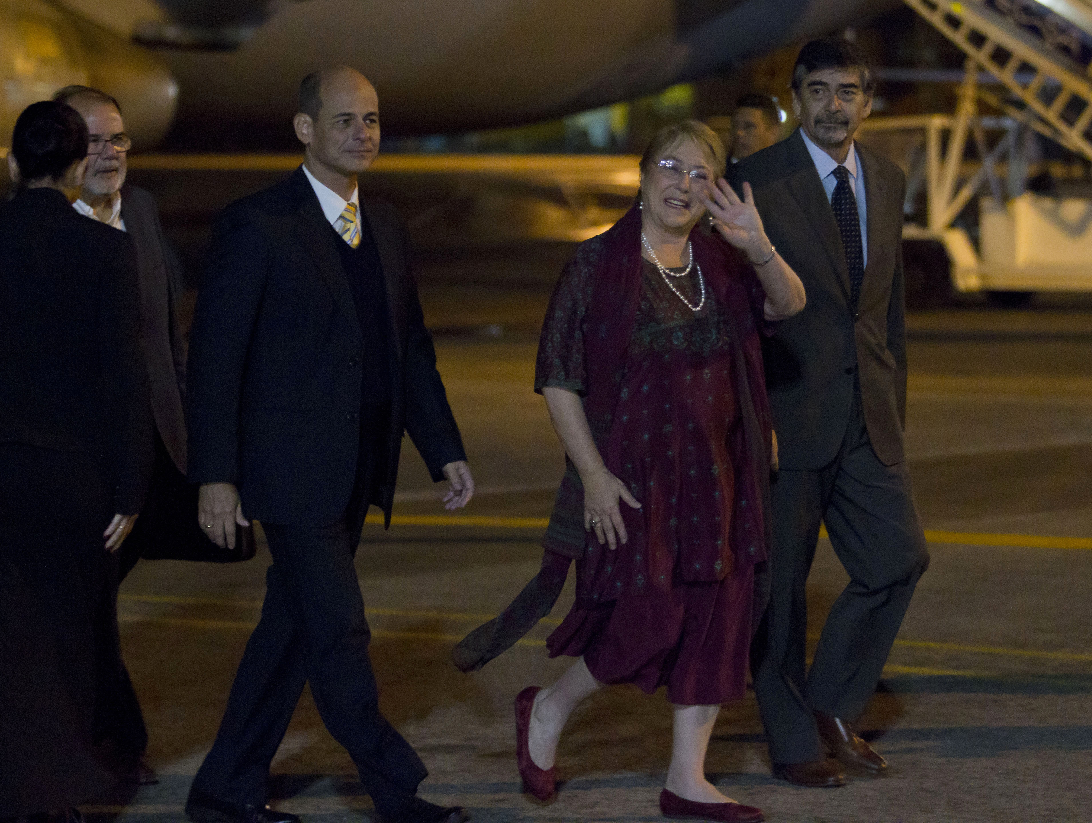 Chilean President Michelle Bachelet (C) waves after arriving at Jose Marti International Airport in Havana, Cuba, on Jan. 7, 2018.