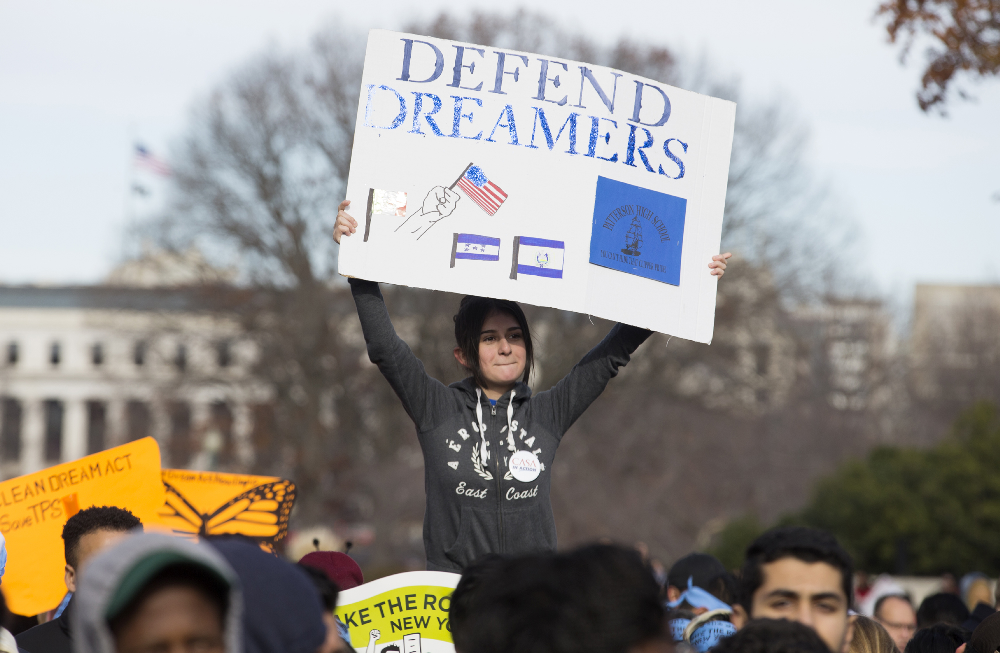 A youth holds a sign at a rally held to voice support for the passage of the 'clean' DREAM Act, in Washington, DC, USA, Dec. 6, 2017.