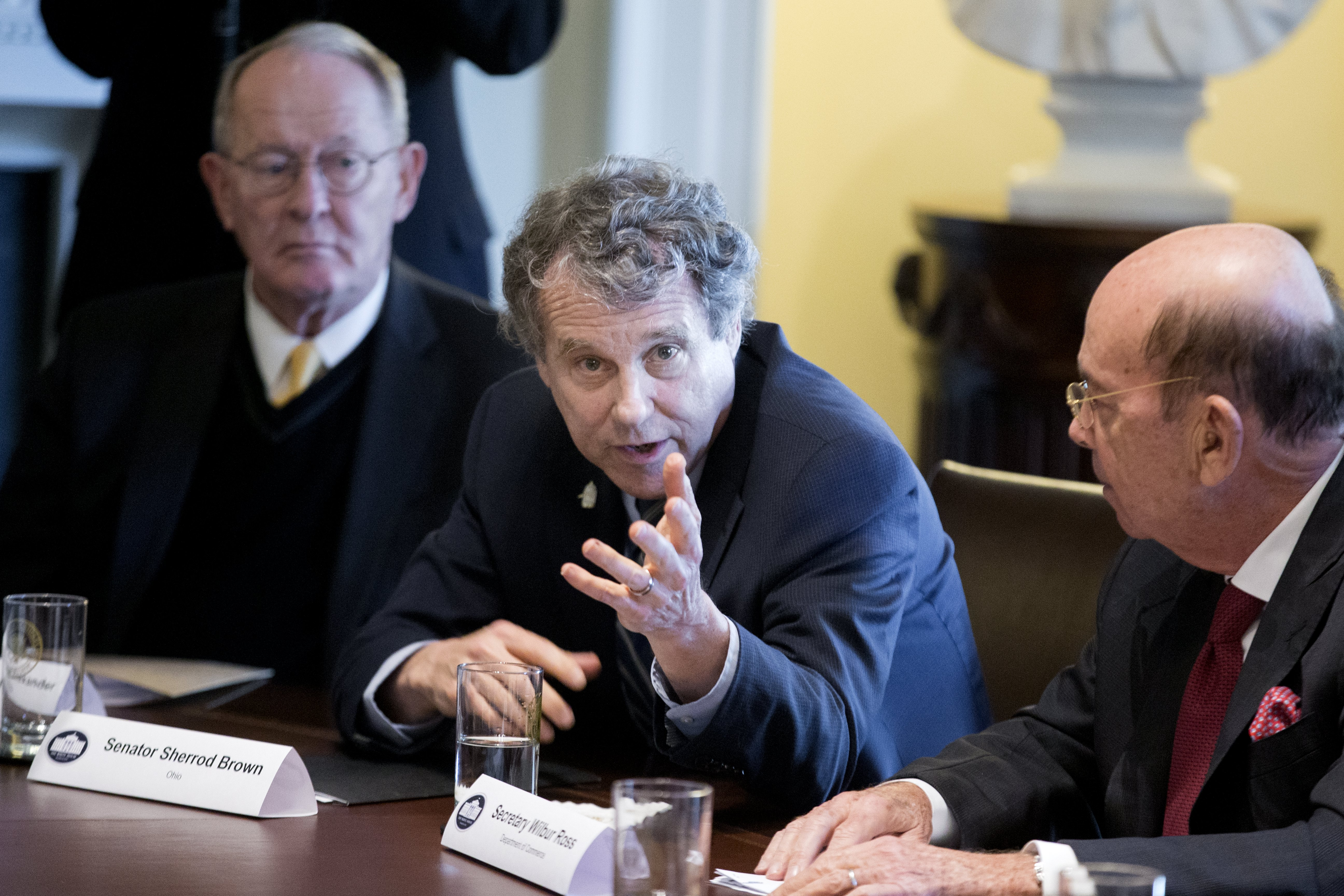 Democratic Senator from Ohio Sherrod Brown (C) speaks beside Republican Senator from Tennessee Lamar Alexander (L) and US Commerce Secretary Wilbur Ross (R) during a meeting on trade and the economy with members of Congress and US President Donald J. Trump (not pictured), in the Cabinet Room of the White House in Washington, DC, USA, Feb. 13, 2018. EPA-EFE