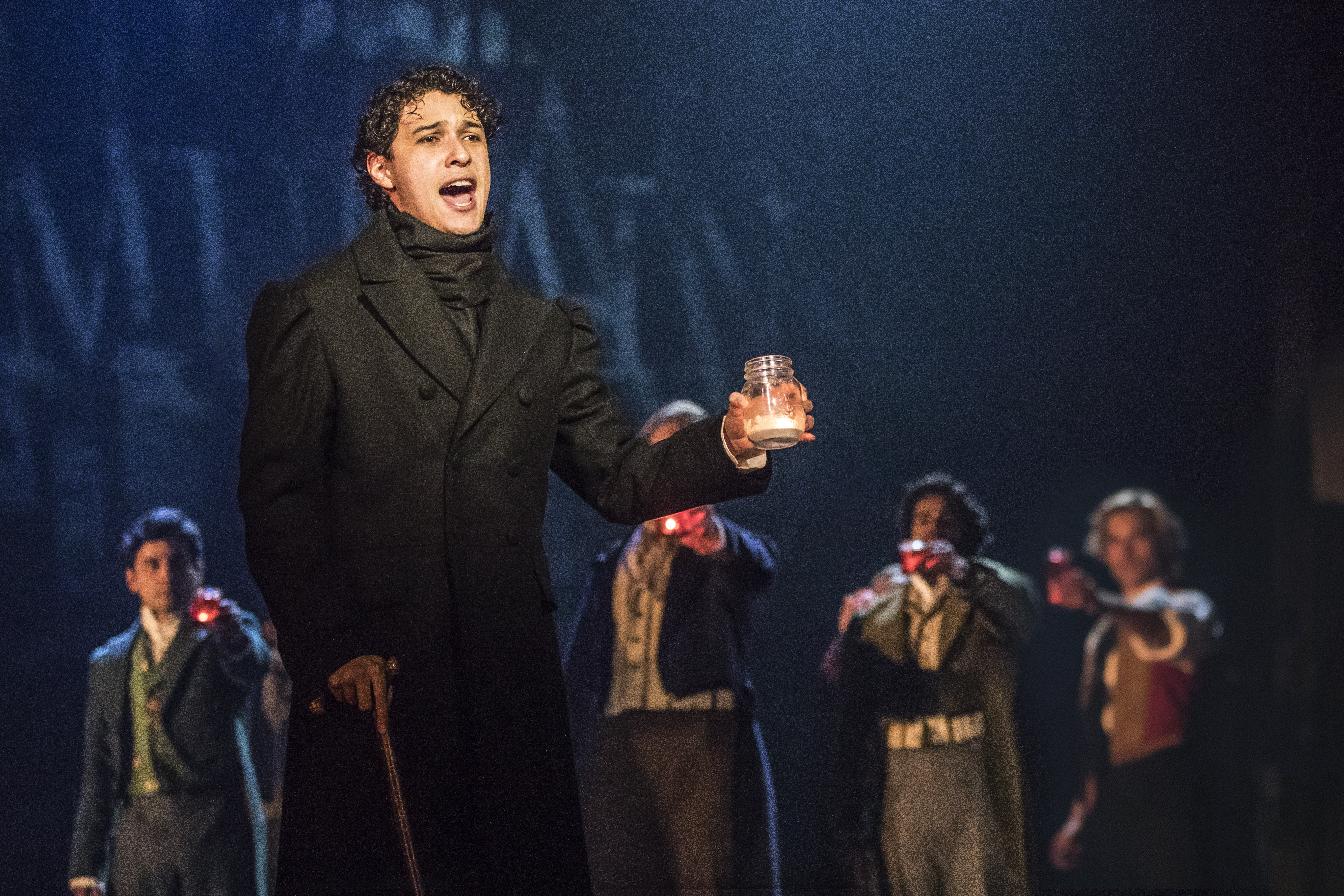 """Joshua Grosso as Marius in the second act of Les Misérables, singing the song """"Empty Chairs at Empty Tables"""". This photograph is provided by the national tour's official photographers. All rights are reserved to them."""