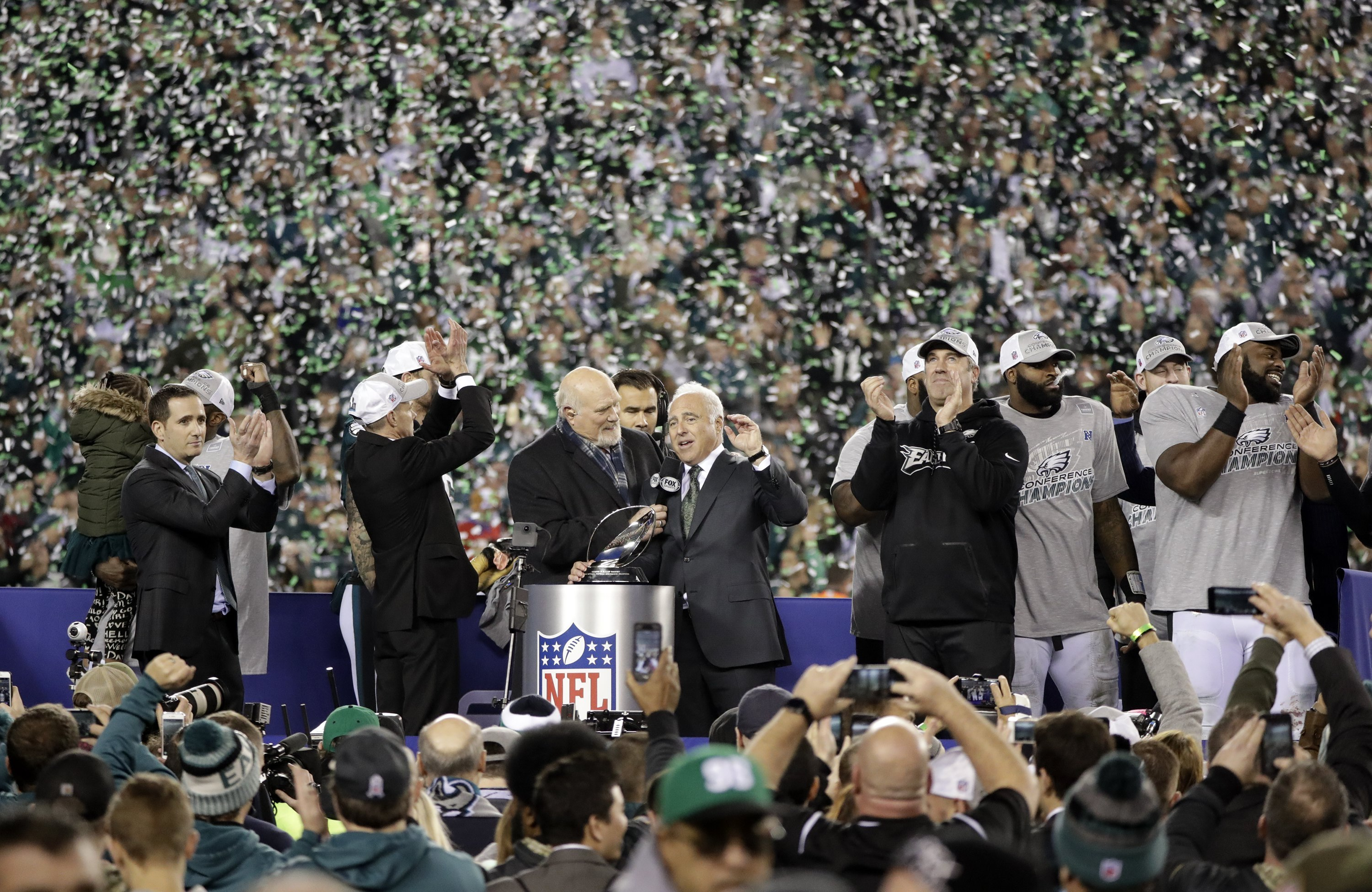 Philadelphia Eagles owner Jeffrey Lurie (C) talks to the fans in the stadium next to NFC Championship trophy at the conclusion of his team after they defeated the Minnesota Vikings at Lincoln Financial Field in Philadelphia, Pennsylvania, USA, 21 January 2018. EPA-EFE