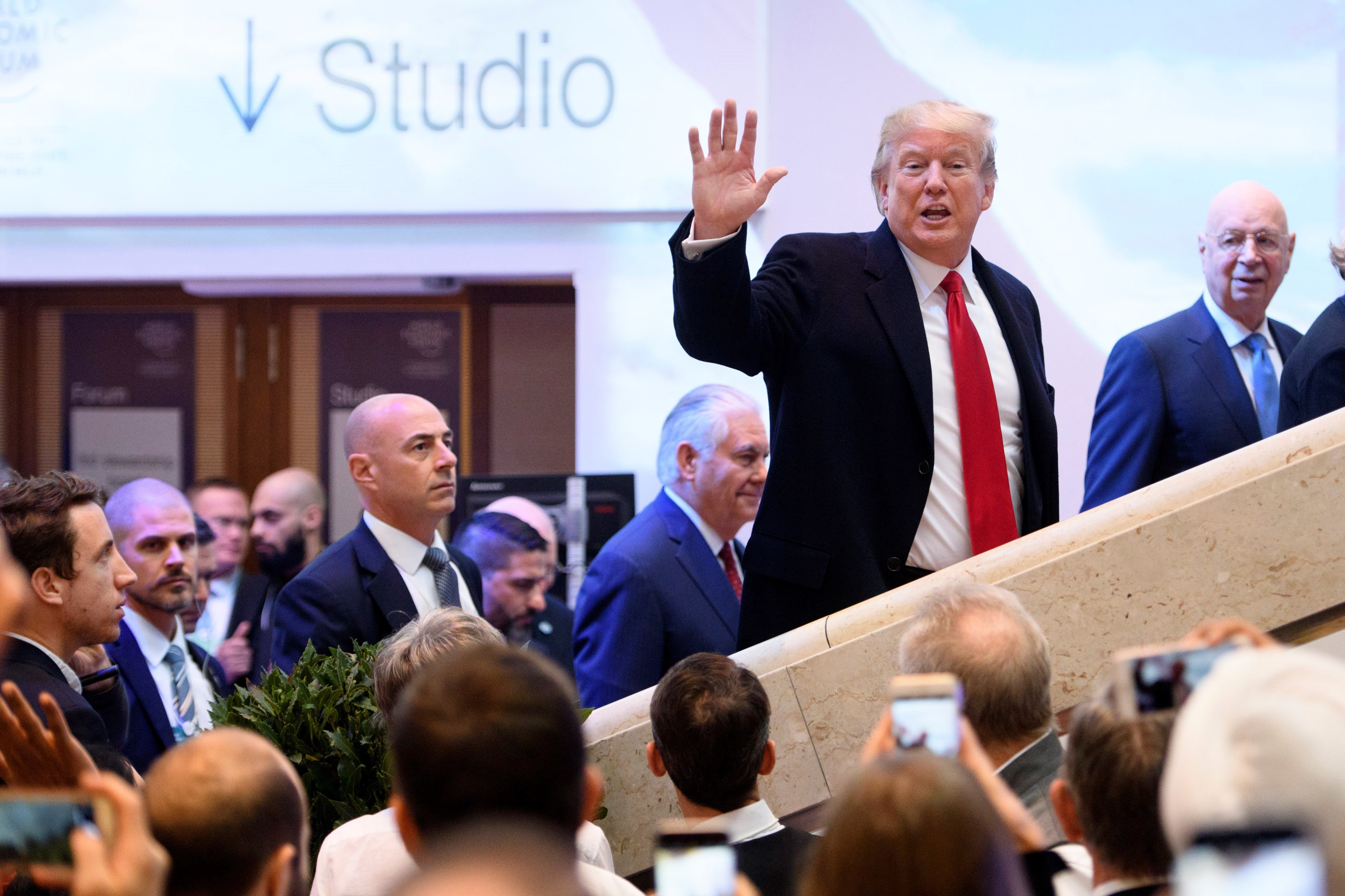 US President Donald Trump waves to reporters after participating in a session at the World Economic Forum in Davos, Switzerland, on Jan. 25, 2018.