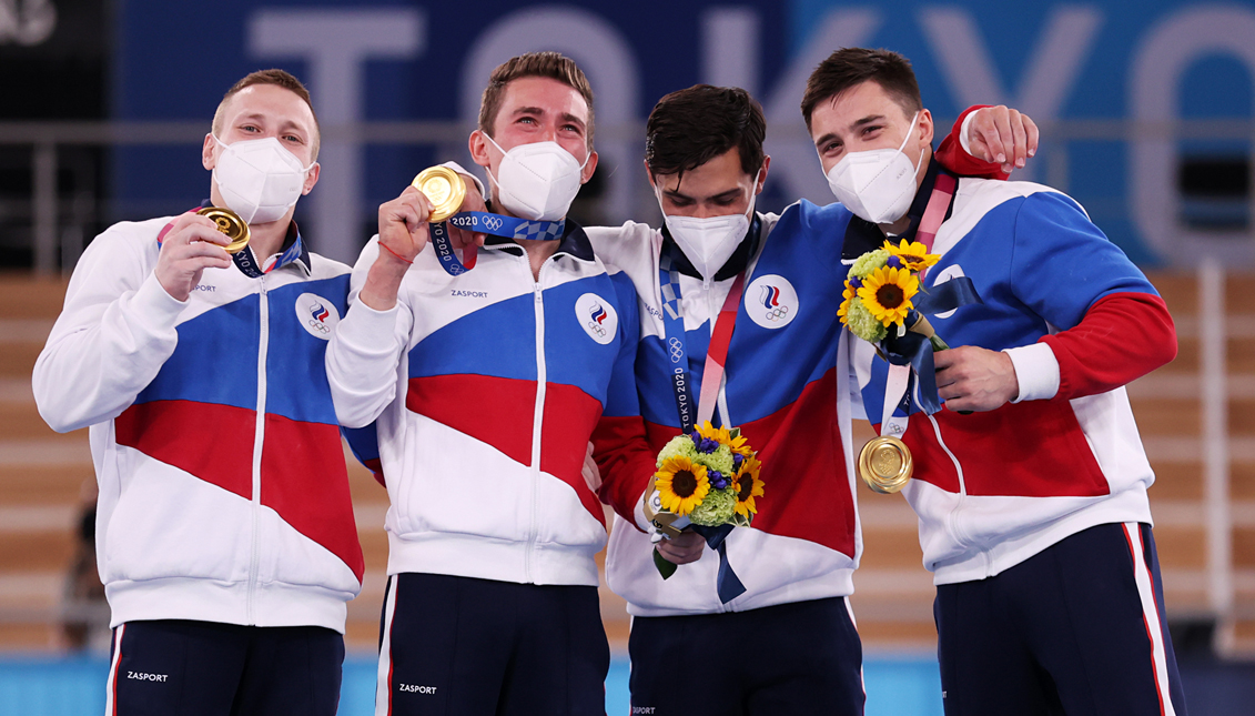 ROC gymnasts celebrate their gold medal. Getty Images