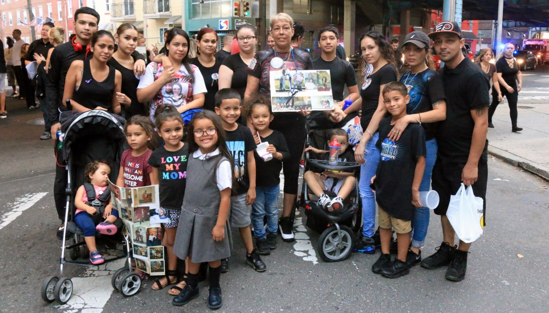 Erasema Delgado, 58, stands with her children and grandchildren at the March In Black event. Delgado and her family marched for the various friends and family members who've lost their lives to drugs and addiction.