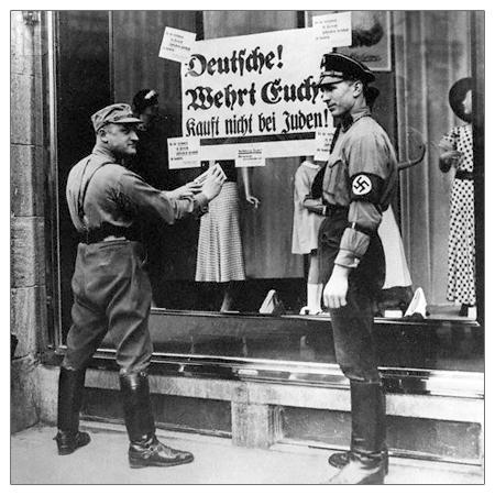 """Arriba: La pancarta dice """"No compre judía""""."""