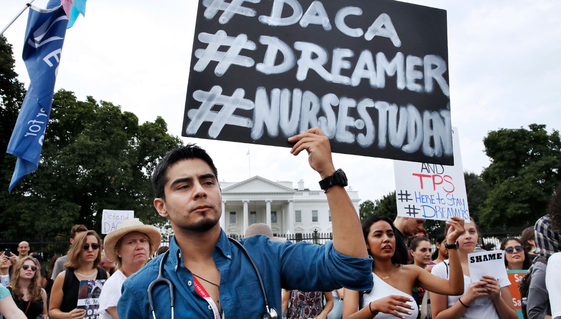 Carlos Esteban, 31, of Woodbridge, Va., a nursing student and recipient of Deferred Action for Childhood Arrivals, known as DACA, rallies with others in support of DACA outside of the White House, in Washington, Tuesday, Sept. 5, 2017. President Donald Tr