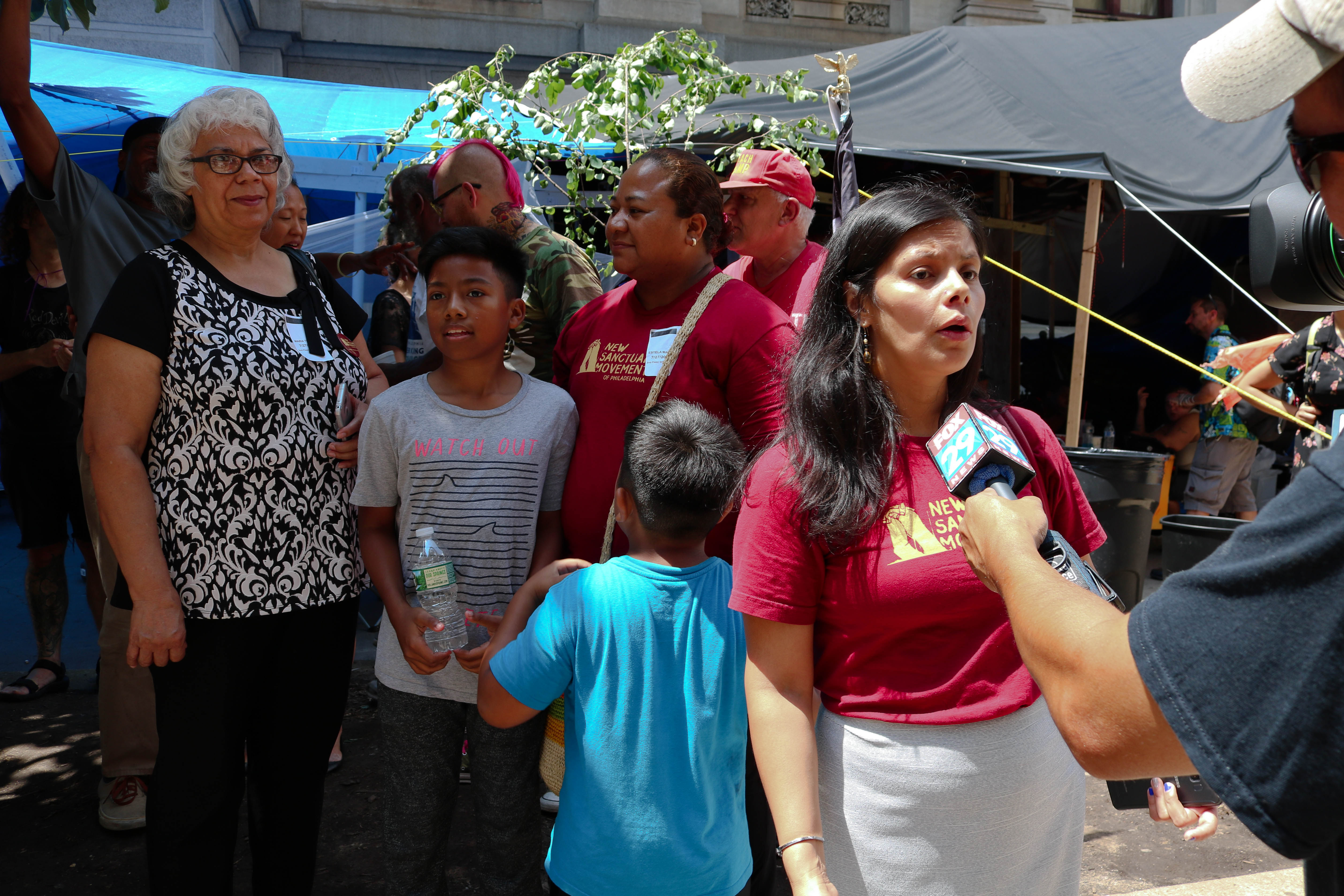 Blanca Pacheco, co-director of the Sanctuary Movement being interviewed by Fox 29 at the Occupy ICE encampment