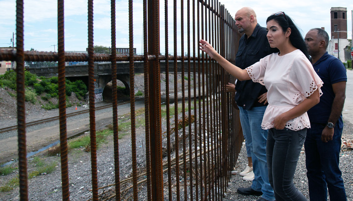 "John Fetterman, Gisele Barreto Fetterman, and Danilo Burgos visited the former site of ""El Campamento"" on Sept. 22."
