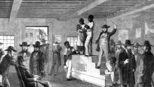 A slave auction in Virginia. Rischgitz/Getty Images