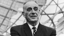 American urban planner Robert Moses (1888-1981), president of the World's Fair stands in front of the Unisphere monument at the World's Fair site in Flushing, Queens, New York City, 1964. Photo: Archive Photos / Getty Images
