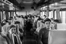 Migrants board a bus in Navojoa. Photo by Ada Trillo
