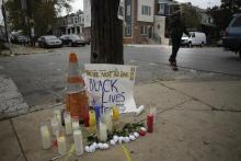 Candles and plastic roses rest at a memorial for Walter Wallace Jr. in the 6100 block of Locust Street on October 28, 2020 in Philadelphia, Pennsylvania. Photo: Joshua Lott/ The Washington Post via Getty Images.