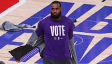 "LeBron James, wearing a ""Vote"" tshirt during a game. Photo: Getty Images"