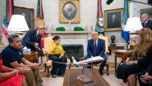 US President Donald Trump (4th R) speaks with Gloria Guillen (4th L), the mother of Vanessa Guillen, a Fort Hood soldier found dead after disappearing from Fort Hood, Texas, and family members in the Oval Office of the White House in Washington, DC, on July 30, 2020. Getty Images
