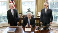 US President Donald Trump reacts after Republicans pulled their health care bill from the House floor on Friday in the Oval Office of the White House in Washington, DC, 24 March 2017, as US Vice President Mike Pence (R) and US Secretary of Health and Human Services (HHS) Tom Price (L) look on. EPA/Olivier Douliery / POOL