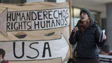 Kate Canelstein with Vermont Workers Center, address a rally demanding the release of two activists, Zully Palacios and Enrique Balcazar, who are community organizers with Migrant Justice, and detained migrant worker Alex Carrillo, outside the John F Kennedy Federal Building in Boston, Massachusetts, USA 27 March 2017. EPA/CJ GUNTHER