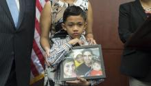 Seven-year-old Walter Escobar of Texas holds a photo of his family, including his father Jose Escobar that was deported from the US; at a news conference held by US Democratic Senators, the National Council of La Raza and immigration advocates, on Capitol Hill in Washington, DC, USA, 28 March 2017. EPA/MICHAEL REYNOLDS