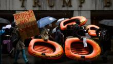 People carrying inflatable rafts, a form of transportation used by refugees, march against the Trump administration's proposed immigration and refugee policies in front of a Trump Building in lower Manhattan in New York, New York, USA, 28 March 2017. EPA/JUSTIN LANE
