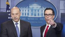 US Treasury Secretary Steven Mnuchin (R) and National Economic Director Gary Cohn (L) participate in a news conference to discuss the tax reform plan of US President Donald J. Trump, in the James Brady Press Briefing Room at the White House in Washington, DC, USA, 26 April 2017. EPA/MICHAEL REYNOLDS