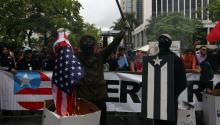 People demonstrate during the general strike against austerity measures, which coincides with the International Workers Day, in San Juan, Puerto Rico, May 1, 2017. EFE/THAIS LLORCA