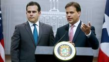 Puerto Rico Gov. Ricardo Rossello Nevares (L), next to representative to the Fiscal Oversight Boar (JSF), Elias Sanchez (R), during a press conference at La Fortaleza Governor residence. Puerto Rico on Wednesday sought relief under a law enacted to help the United States commonwealth restructure its massive debt load, paving the way for what could be the largest-ever bankruptcy case involving a US local government entity.. EFE