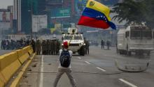 Opposition demonstrators clash with Bolivarian Guard in Caracas, Venezuela, 03 May 2017. Venezuela's Bolivarian National Guard (GNB) used tear gas to keep opposition demonstrations from reaching the center of the Venezuelan capital. EPA/MIGUEL GUTIERREZ