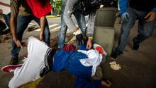 A protester is injured as anti-government demonstrators clash with police in Caracas, Venezuela, 04 May 2017. Members of the Bolivarian National Guard dispersed a student demonstration at the Universidad Central de Venezuela when the protesters tried to make their way to the Interior and Justice Ministry facilities, in downtown Caracas. EPA/MIGUEL GUTIERREZ