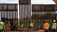 Workers install the last iron panel of the border fence segment near Naco port of entry, in Arizona, United States on May 9, 2017. EFE/CBP
