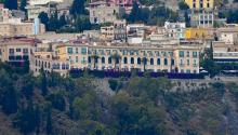 A panoramic view the Hotel San Domenico, one of the venues of the G7, on the top of the coast of Giardini Naxos, 25 May 2017, ahead of the G7 summit scheduled for May 26 and 27 in Taormina, southern Italy. EPA/CIRO FUSCO