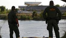 United States Border Patrol (USBP) agents stand beside a raft, reportedly used by people to cross the river, under the bridge along the Rio Grande River near Rio Grande City, Texas, USA, 01 March 2017. EPA/LARRY W. SMITH
