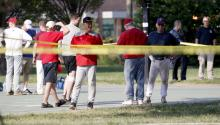 People stand near the scene of a shooting at the practice of the Republican congressional baseball team at Eugene Simpson Stadium Park in Alexandria, Virginia, USA, 14 June 2017. EPA/SHAWN THEW