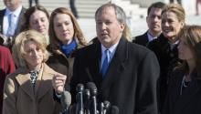 Texas Attorney General Ken Paxton (C) delivering remarks to the news media, at the Supreme Court on Capitol Hill in Washington, DC, USA, Mar. 2, 2016. EFE/Shawn Thew