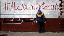 A protester holds rocks in his hands during riots with members of the National Bolivarian Guard (GNB) in Caracas, Venezuela, 27 July 2017. EPA/MIGUEL GUTIERREZ