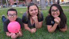 Photo taken in Los Angeles on July 29, 2017 showing Guatemalan Vanesa Pineda (c) with two of her children - Jose (l) and Arleth (r). EFE/Ivan Mejia