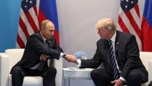Russian President Vladimir Putin (L) and US President Donald J. Trump (R) shake hands during their meeting on the sidelines of the G20 summit in Hamburg, Germany, 07 July 2017 (reissued 30 July 2017). EPA/MICHAEL KLIMENTYEV / SPUTNIK / KREMLIN POOL