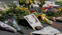 People place flowers at the corner of Fourth and East Water Street in Charlottesville, Virginia, USA, 13 August 2017. A woman killed when a car slammed into counter-protesters at that intersection following the cancelation of a planned white supremacist march in that city was identified on 13 August 2017 by authorities as 32-year-old Heather Heyer. EPA/TASOS KATOPODIS