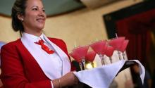 A waitress serves several daiquiris at the Floridita bar/restaurant in Havana, Cuba, 16 August 2017. The daiquiri attracts thousands to its birthplace, Floridita, which is marking its 200th anniversary, each year, but perhaps the establishment is best known as having been a frequent hangout of late Nobel literature laureate Ernest Hemingway during his long stays in Cuba. EFE/Alejandro Ernesto