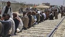 Afghan refugees wait to be processed at a border post in Quetta, Pakistan, on Monday, Aug. 21. EFE/Jamal Taraqai