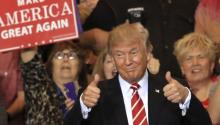 US President Donald J. Trump gives a thumbs up to the crowd as he enters the Phoenix Convention Center for a campaign rally in Phoenix, Arizona, USA, 22 August 2017. EPA/ROY DABNER