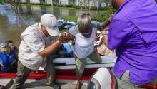 A flood victim (C) is helped into a boat by Danny Owens (L) and Brian Burden (R) as evacuations take place near Buffalo Bayou in the aftermath of Hurricane Harvey in Houston, Texas, USA, 30 August 2017. EPA-EFE/TANNEN MAURY