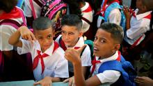 Three children pose for a photo during the start date of the 2017-2018 school year, in Havana, Cuba on Sept. 4, 2017. EPA-EFE/Alejandro Ernesto
