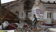 People walk next to buildings affected by the earthquake, in the town of Ixtaltepec, Oaxaca, Mexico on Sept. 10, 2017. EPA-EFE/Jorge Nunez
