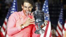 Rafael Nadal of Spain celebrates with the championship trophy after defeating Kevin Anderson of South Africa to win the US Open Tennis Championships men's final round match at the USTA National Tennis Center in Flushing Meadows, New York, USA, Sept. 10, 2017. EPA-EFE/JUSTIN LANE
