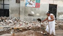 A woman tries to clean up in the aftermath of an earthquake in Juchitan Municipality Oaxaca State, Mexico, Sept. 11, 2017. EPA-EFE/JORGE NUÑEZ