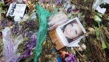 Flowers, candles and other items are placed in memory of Heather Heyer, whose image is seen in this picture, and for those affected by the violence at the site where a vehicle smashed into counter-protesters in Charlottesville, Virginia, USA, 24 August 2017. EPA-EFE FILE/MICHAEL REYNOLDS