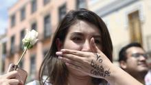 "A woman covers her mouth with her hand on which is written ""Enough of silence"", during a demonstration to reject and demand justice for the murder of Mexican Mara Fernanda Castillo, who was found dead on Sept. 15, 2017 after takin a Cabify Vehicle, in Puebla, Mexico, Sept. 18, 2017. EPA-EFE/Francisco Guasco"