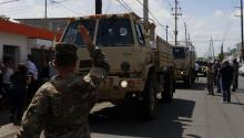 US and Puerto Rico National guard control the admission and distribution of aid in San Juan, Puerto Rico, Sept. 24, 2017. EPA-EFE FILE/Thais Llorca
