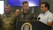 Puerto Rican Governor Ricardo Rossello (R) speaks next to US Admiral Jeffrey Hughes (C) during a press conference at the Government's Command Center in San Juan, Puerto Rico, Sept. 28, 2017. EPA-EFE/Thais Llorca
