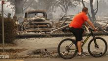 A resident rides past a burnt out home in Santa Rosa, California, USA, 09 October 2017. EPA-EFE/JOHN G. MABANGLO
